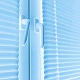 Window with white jalousie Stock Photo
