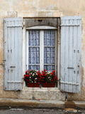 WINDOW WITH WHITE AND RED FLOWERS, PROVENCE, FRANCE Stock Photography