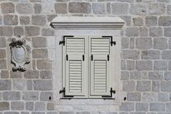 Window with white shutters in Perast, Montenegro. Stock Photo