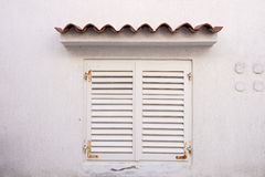 Window with white shutters Stock Image