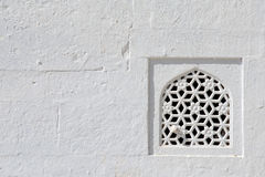 Window and white wall, temple in Rajasthan, India Royalty Free Stock Photo