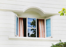 Window in a white wooden country house Stock Images