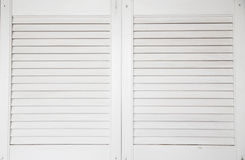 Window with white wooden shutters Stock Photo
