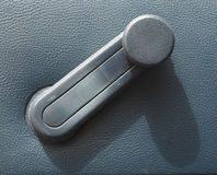 Window winder in a car. The window winder in a car Stock Image