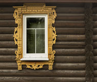 Window. With fine framing in wall of logs Royalty Free Stock Photos