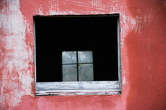 Window Through a Window. I found this building in a field that had a window with now glass and through that window you could see the in tact window on the other Stock Image