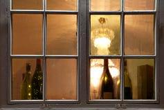 Window with wine bottles Stock Photo