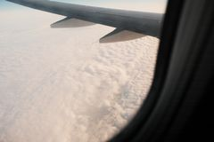 Wing of the airplane over the clouds, copyspace. Window And Wing of the airplane over the clouds, a lot of copyspace Royalty Free Stock Photos