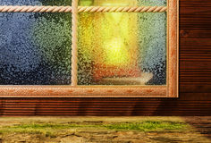Window, winter evening, lantern light Royalty Free Stock Images