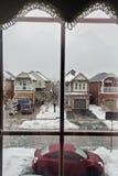 Window. A wintery street scene with net Royalty Free Stock Photos
