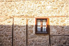 Free Window With Bars In A Stone House Royalty Free Stock Photo - 155769325