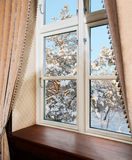 Window With Curtains In Winter Royalty Free Stock Photos