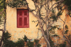 Window With Red Shutter Of Anafiotika In Town Of Athens,Greece. Stock Photo