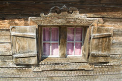 Window of a wodden hut in Austria Stock Images