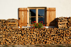 Window With Wood. A typical chalet in the Italian Alps, with flowers and wood Royalty Free Stock Photo