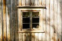 Window wood in old farm house, Norway. An old falling down farm house Telemark, Norway. Norwegian oldest wooden grey farm house. Old abandoned norwegian farm Stock Photos
