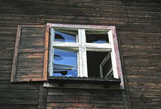 Window of wooden abandoned house. In Alps stock images
