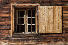 Window of a wooden alpine hut. Rustic background Royalty Free Stock Photos