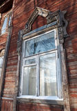 The window with the wooden architrave. stock photography