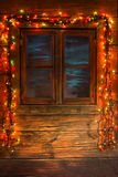 Window. Wooden window with colorful Christmas lights Stock Images