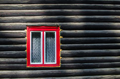 Window of a wooden cottage Stock Photos