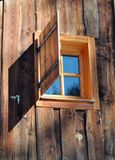 Window on a wooden cottage Stock Photos