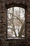 Window with a wooden frame without glass behind which you can see the nature. Vintage window with a wooden frame without glass behind which is seen the nature of Royalty Free Stock Photo