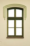 Window with a wooden green frame.  Stock Photos