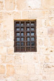 window with wooden grill on ancient wall Royalty Free Stock Photography