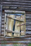 Window of wooden house closed with collapsed shutter. Everyday objects in Museum and abandoned old houses. Window of wooden house closed with collapsed shutter Stock Images