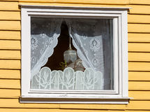 Window in a wooden house with white curtains Stock Photography