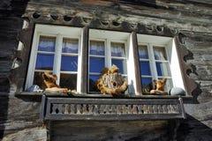 Window of wooden house in Zermatt Resort, Switzerland Royalty Free Stock Images