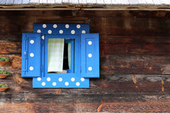 Window on wooden hut wall Stock Photography