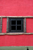 Window wooden. On red wall Stock Photo