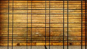 Window with wooden shutters and black bars stock photos