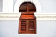 Window with wooden shutters in San Juan, Puerto Rico. Window with wooden shutters on grey wall background in San Juan, Puerto Rico. House with plastered facade royalty free stock photos