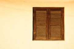 Window with wooden shutters. Stock Photo