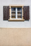 Window with a wooden shutters Stock Images
