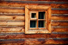 Window in wooden wall Stock Photo