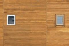 Window on wooden wall Stock Photo