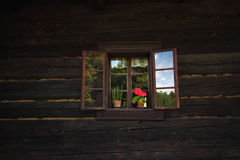 Window on the wooden wall Royalty Free Stock Photo