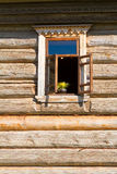 Window in a wooden wall. Stock Photo