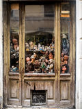Window with worn out dolls Royalty Free Stock Photography
