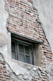 Window on wrecked wall. Window on aged and wrecked wall, shown as a kind of living environment Stock Image