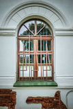 Window with wrought iron bars. Window on an old European building with wrought iron bars Royalty Free Stock Photos