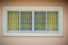 Window with wrought iron to prevent theft. Newly built house wit Stock Images