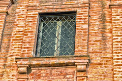 Window of XVIII century oratory church. Window in the brickwall facade of an early XVIII century  oratory, church dedicated to St. Dorothea  in the village of Stock Images