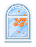 Window with yellow autumn leaves Royalty Free Stock Image