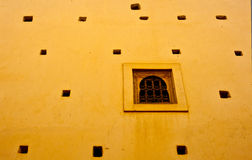 Window on the yellow. Typical arabic window on a yellow wall intense Stock Photography