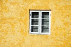 Window in yellow wall Royalty Free Stock Images